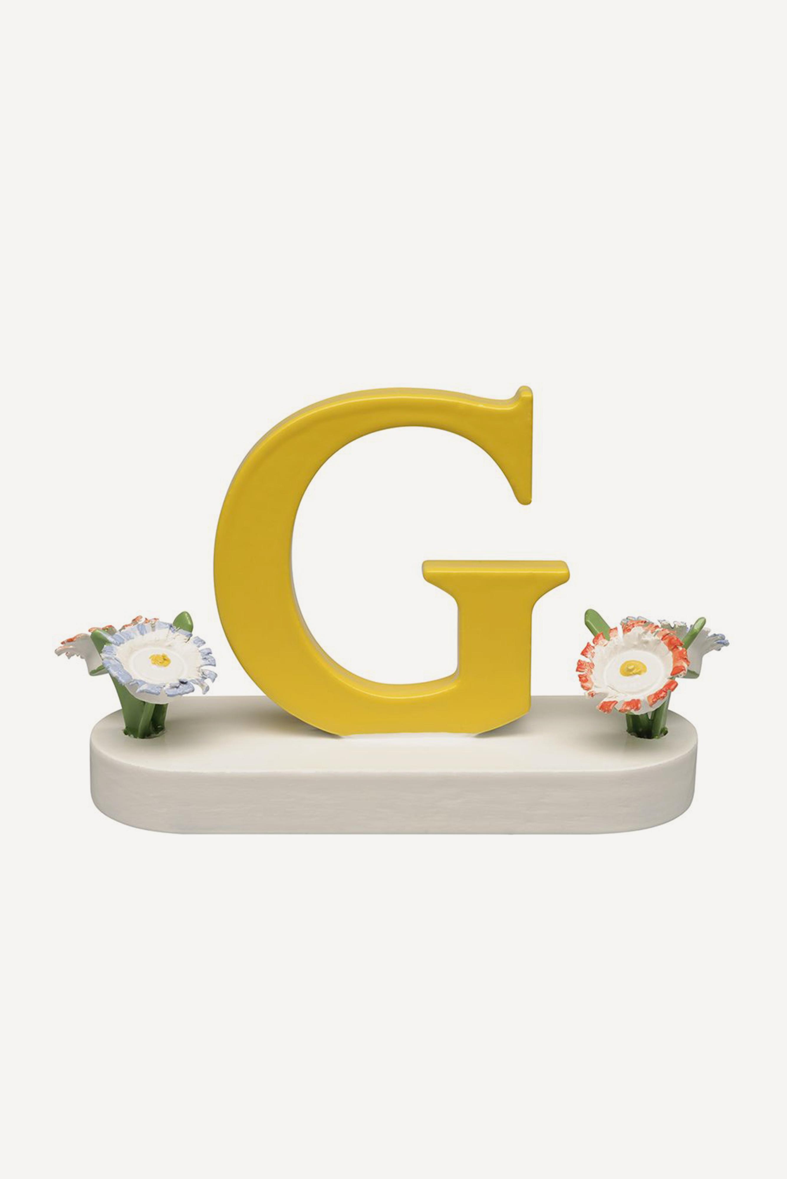 Buchstabe G, mit Blumen