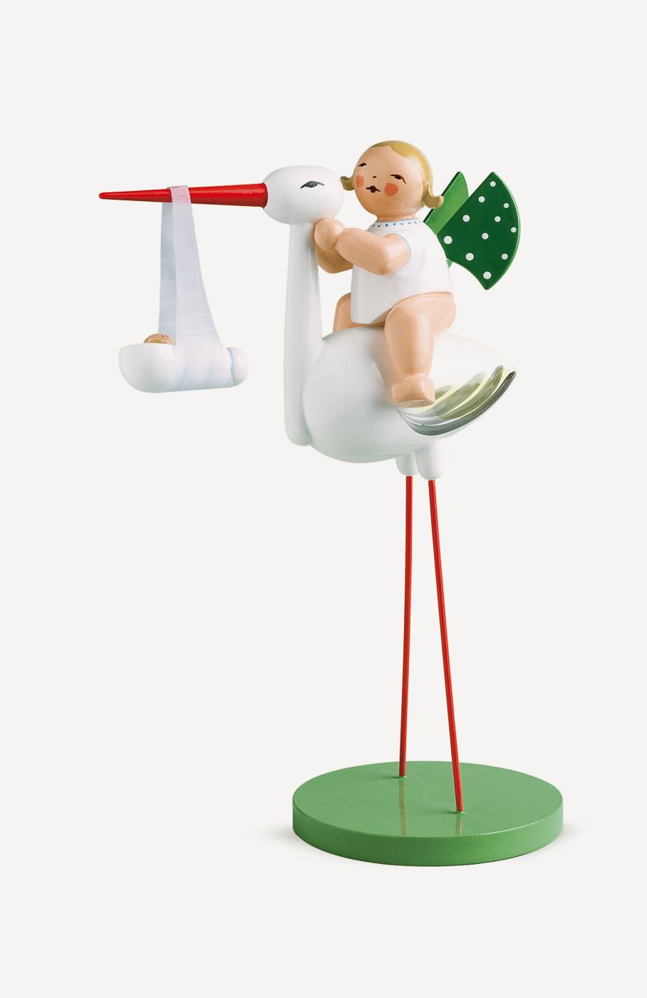 Storch mit Wickelkind, Junge