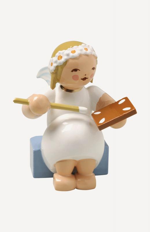 aMargeritenengel, sitzend, mit Pfefferkuchen